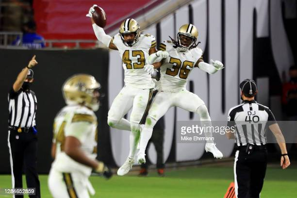Marcus Williams of the New Orleans Saints celebrates with D.J. Swearinger after intercepting a pass during the second quarter against the Tampa Bay...