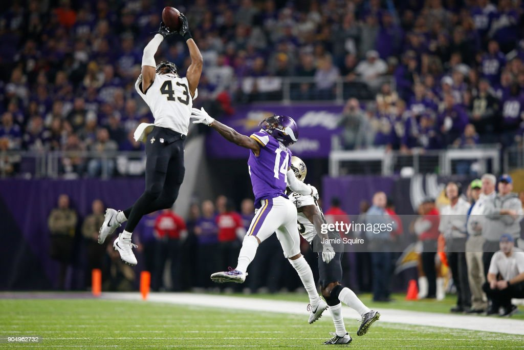 Marcus Williams #43 of the New Orleans Saints intercepts a pass intended for Stefon Diggs #14 of the Minnesota Vikings during the second half of the NFC Divisional Playoff game at U.S. Bank Stadium on January 14, 2018 in Minneapolis, Minnesota.