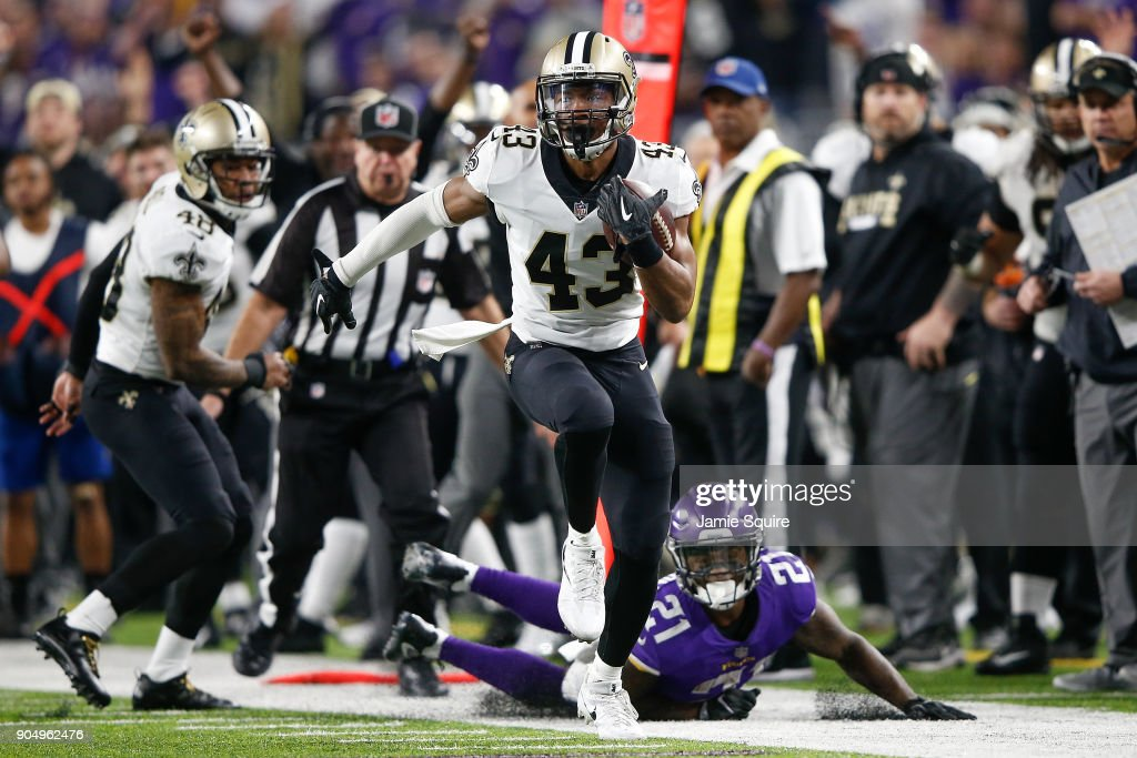 Marcus Williams #43 of the New Orleans Saints runs with the ball after a interception against the Minnesota Vikings during the second half of the NFC Divisional Playoff game at U.S. Bank Stadium on January 14, 2018 in Minneapolis, Minnesota.