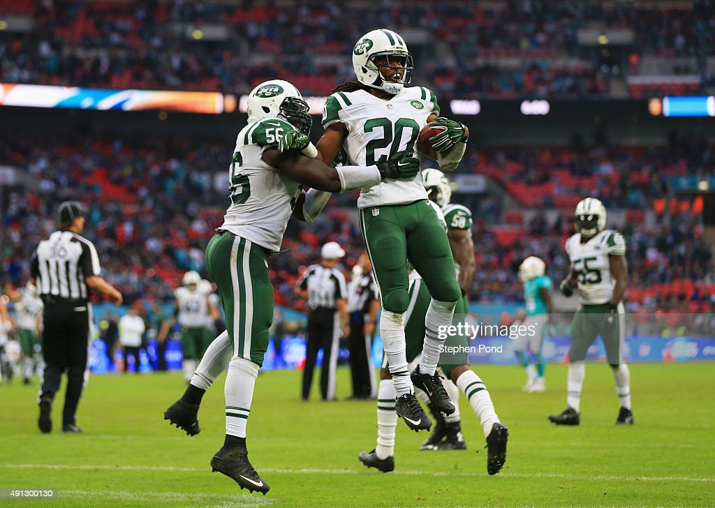 Marcus Williams #20 of the New York Jets celebrates his interception with Demario Davis #56 of the New York Jets during the game against Miami Dolphins at Wembley Stadium on October 4, 2015 in London, England.