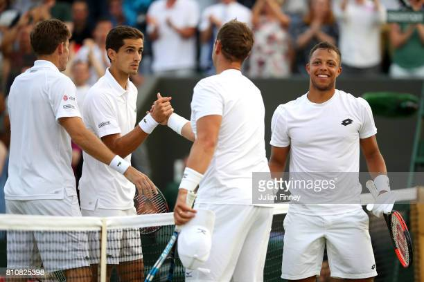 Marcus Willis of Great Britain and Jay Clarke of Great Britain shake hands with PierreHugues Herbert of France and Nicolas Mahut of France after the...