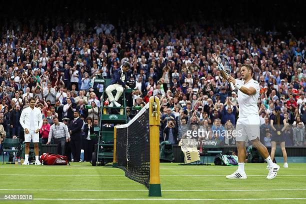 Marcus Willis of Great Britain applauds supporters following defeat during the Men's Singles second round match against Roger Federer of Switzerland...