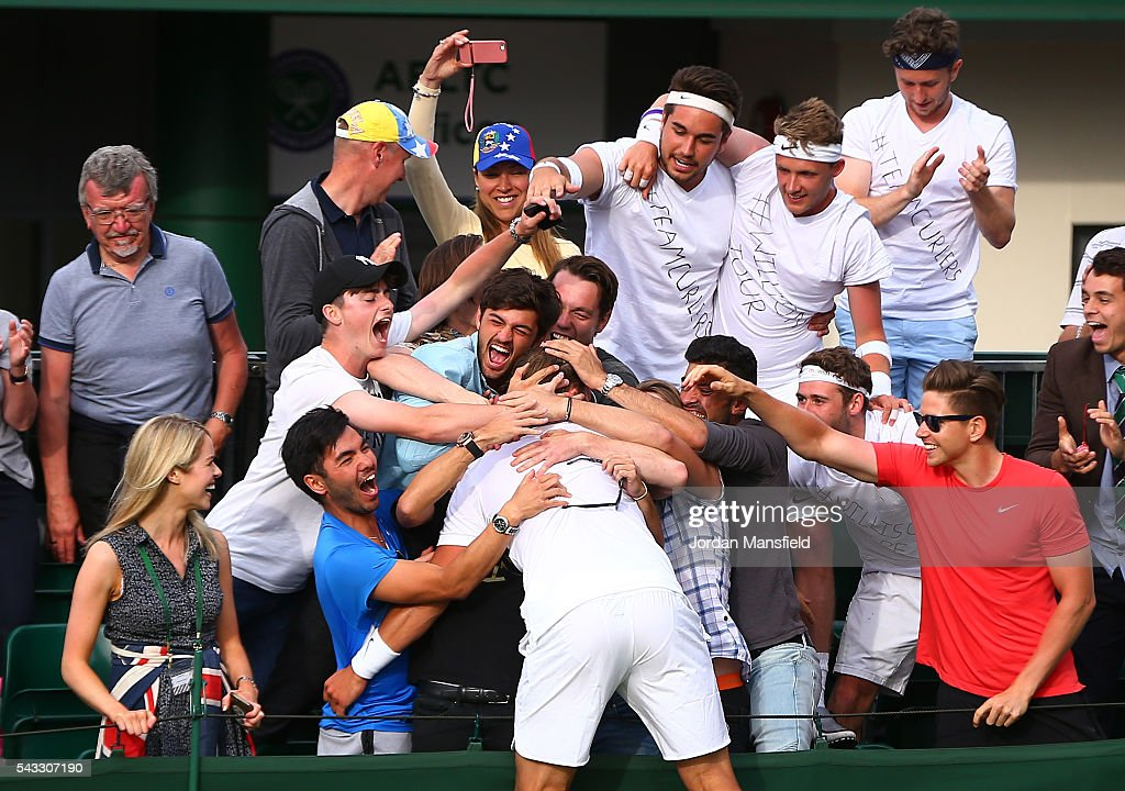 Marcus Willis of Great Britain celebrates victory with supporters during the Men's Singles first round match against Ricardas Berankis of Lithuania on day one of the Wimbledon Lawn Tennis Championships at the All England Lawn Tennis and Croquet Club on June 27th, 2016 in London, England.