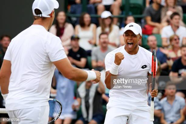 Marcus Willis of Great Britain celebrates with Jay Clarke of Great Britain during the Gentlemen's Doubles second round match against PierreHugues...