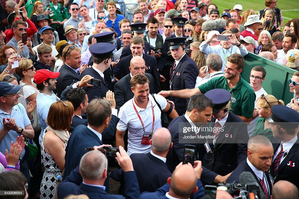 Marcus Willis of Great Britain leaves the court following victory victory during the Men's Singles first round match against Ricardas Berankis of Lithuania on day one of the Wimbledon Lawn Tennis Championships at the All England Lawn Tennis and Croquet Club on June 27th, 2016 in London, England.