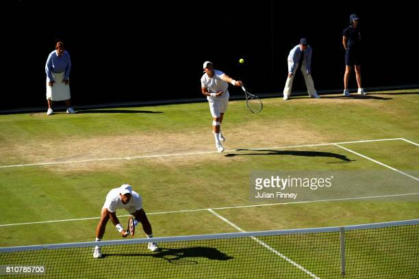 Marcus Willis of Great Britain serves during the Gentlemen's Doubles second round match with Jay Clarke of Great Britain against PierreHugues Herbert...