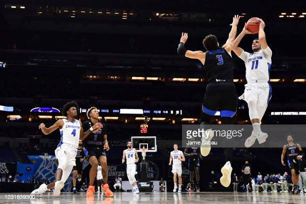 Marcus Zagarowski of the Creighton Bluejays drives to the basket in the first half as JaQuori McLaughlin of the UC Santa Barbara Gauchos defends in...