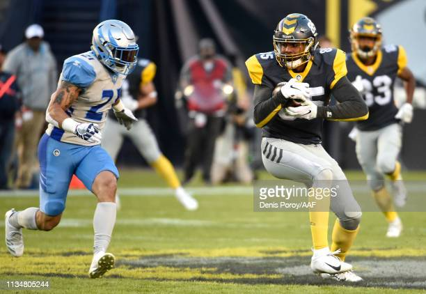 Marcus Baugh of the San Diego Fleet runs with the ball against Cody Brown of the Salt Lake Stallions during the first half of the Alliance of...
