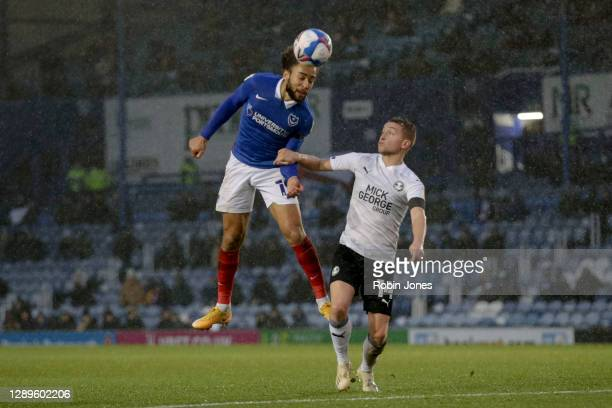 Marcuss Harness of Portsmouth FC and Louis Reed of Peterborough United during the Sky Bet League One match between Portsmouth and Peterborough United...