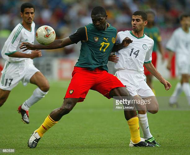 MarcVivien Foe of Cameroon wins the battle in midfield against Abdulaziz al Khathran of Saudi Arabia during the FIFA World Cup Finals 2002 Group E...