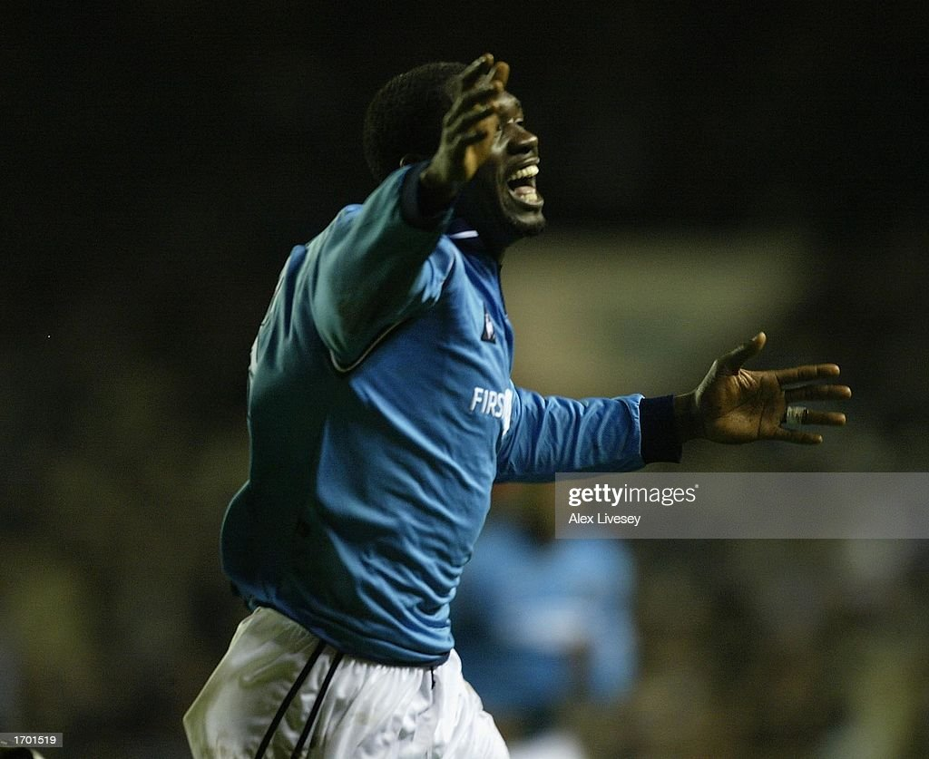 https://media.gettyimages.com/photos/marcvivien-foe-of-manchester-city-celebrates-his-second-goal-during-picture-id1701519