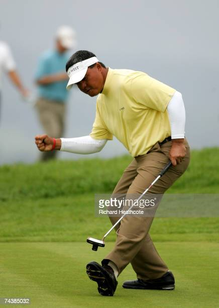 Mardan Mamat of Singapore celebrates as he holes a massive birdie putt on the 17th during the final round of The Celtic Manor Wales Open on the Roman...