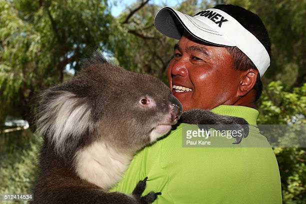 Mardan Mamat of Singapore holds Sunshine the koala during day two of the 2016 Perth International at Karrinyup GC on February 26 2016 in Perth...
