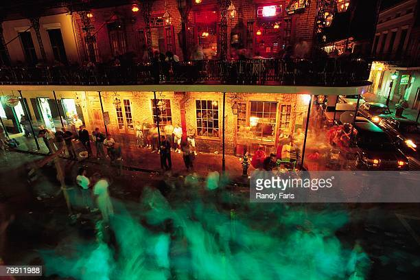 mardi gras at bourbon street - new orleans mardi gras stock photos and pictures
