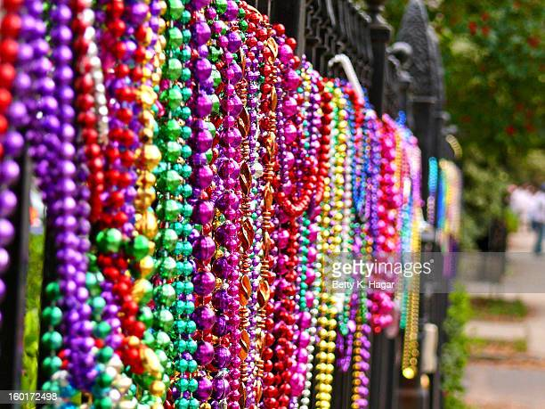 CONTENT] Mardi Gras beads hanging on a fence along Napoleon St Mardi Gras New Orleans LA ~ 2009