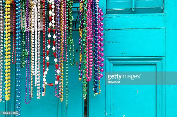 mardi gras beads in new orleans - new orleans french quarter stock photos and pictures
