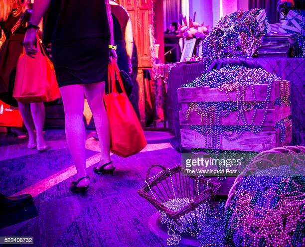 Mardi Gras beads overflowing at the Louisiana state table at the 34th annual Taste of the South charity gala on Saturday April 16 at the Washington...