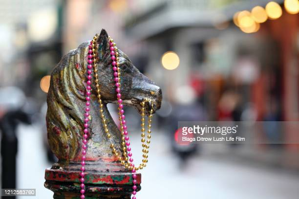 mardi gras beads - louisiana stock pictures, royalty-free photos & images