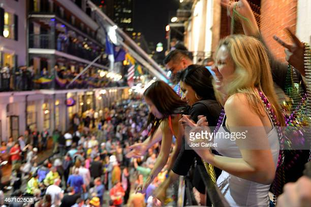 mardi gras celebrations on balcony and street - mardi gras party stock photos and pictures