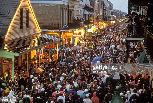 mardi gras crowd on bourbon street - mardi gras stock pictures, royalty-free photos & images