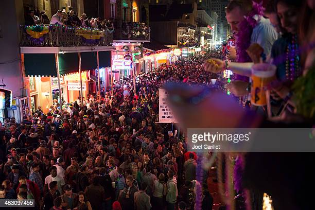 mardi gras crowds in french quarter new orleans - mardi gras party stock photos and pictures
