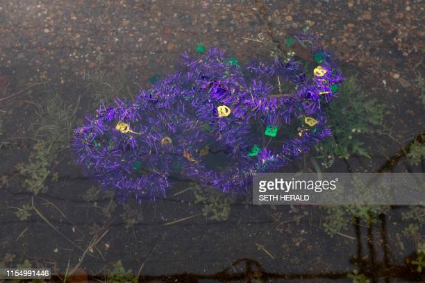 Mardi Gras decorations float in flood waters in a New Orleans neighborhood early on July 10 2019 The US city of New Orleans was under a stormsurge...