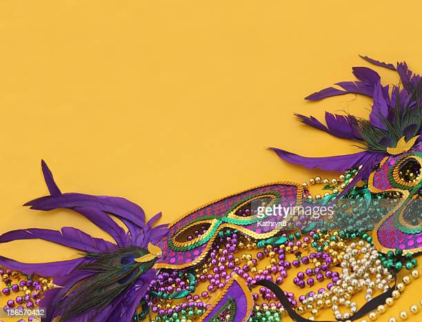 mardi gras in yellow - mardi gras photos stock pictures, royalty-free photos & images