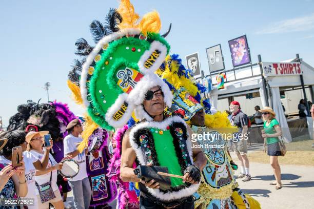 Mardi Gras Indians perform at the New Orleans Jazz Heritage Festival at the Fair Grounds Race Course on April 27 2018 in New Orleans Louisiana