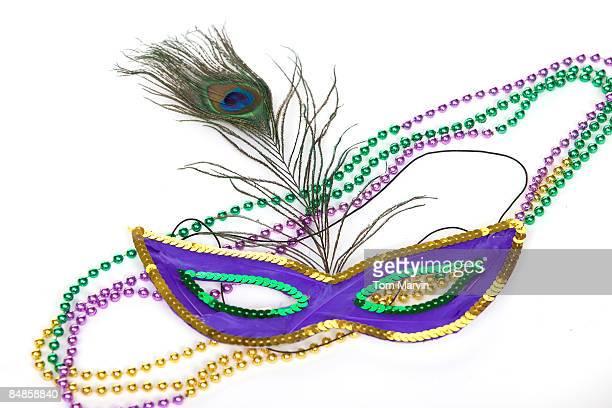 mardi gras mask and necklaces - gras fotografías e imágenes de stock
