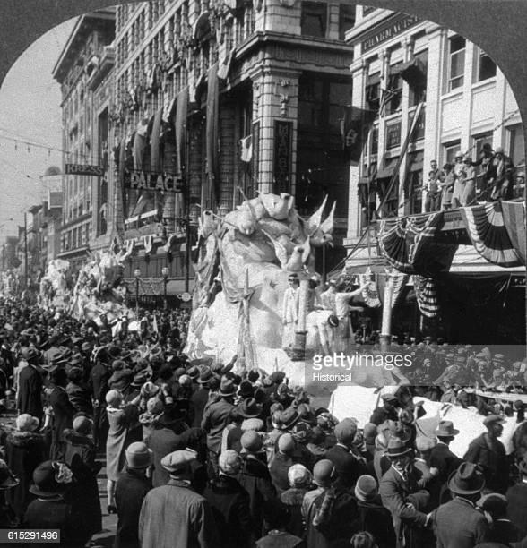 A Mardi Gras parade travels down New Orleans' Canal Street circa 1930