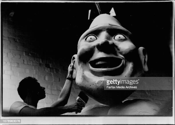Mardi Gras Preparations....Richard Green, workshop volunteer, puts the finishing touches to 'Zippy', A parade character. February 27, 1992. .