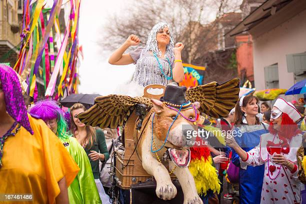 CONTENT] Mardi Gras revelers participating in the Society of Saint Anne parade from the Marigny to the French Quarter in New Orleans