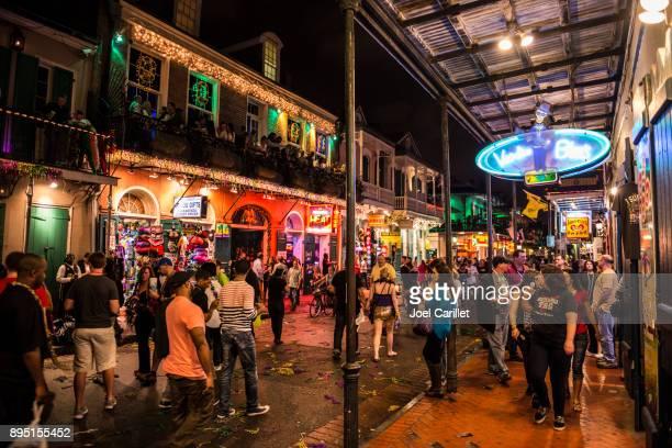 mardi gras revelry on bourbon street, new orleans - mardi gras stock pictures, royalty-free photos & images