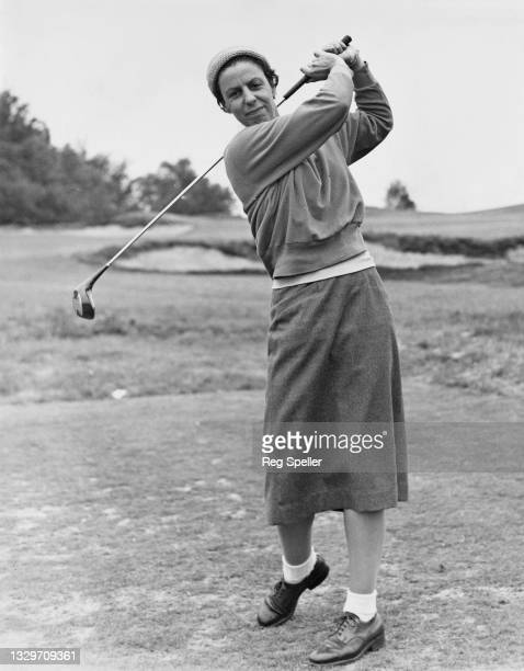 Mardi Mair of Australia drives off the tee during the Women's Amateur Golf Championship on 25th May 1959 at the Berkshire Golf Club in Ascot,...