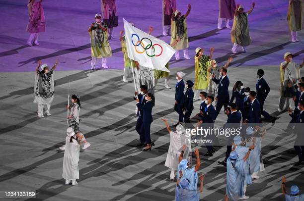 Mardini Yusra and Tachlowini Gabriyesos carry the flag of the Refugee Olympic Team during the Opening Ceremony of the Tokyo 2020 Summer Olympic Games...