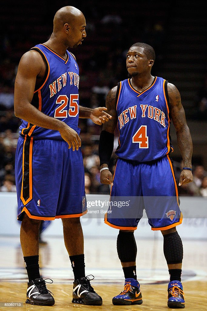 official photos 8b7e4 feafb Mardy Collins and Nate Robinson of the New York Knicks chat ...