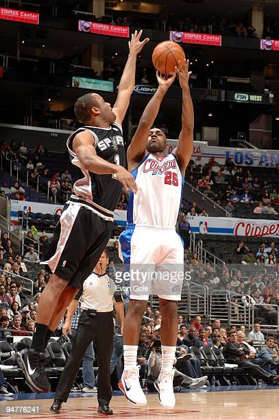 Mardy Collins of the Los Angeles Clippers shoots a jumper against Malik Hairston of the San Antonio Spurs during the game on December 13 2009 at...