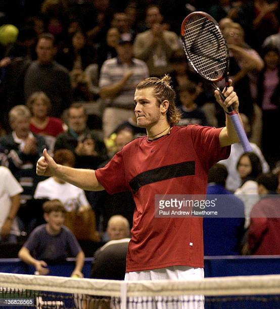 Mardy Fish celebrates his victory over Andre Agassi at the 2004 Siebel Open in San Jose, California, February 14, 2004. Fish upset Agassi to win 5-7,...