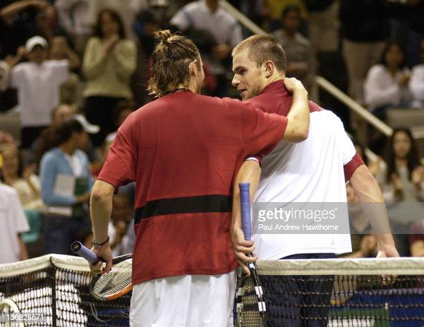 Mardy Fish embraces Andy Roddick at the end of their finals match at the 2004 Siebel Open in San Jose, California, February 15, 2004. Roddick won the...