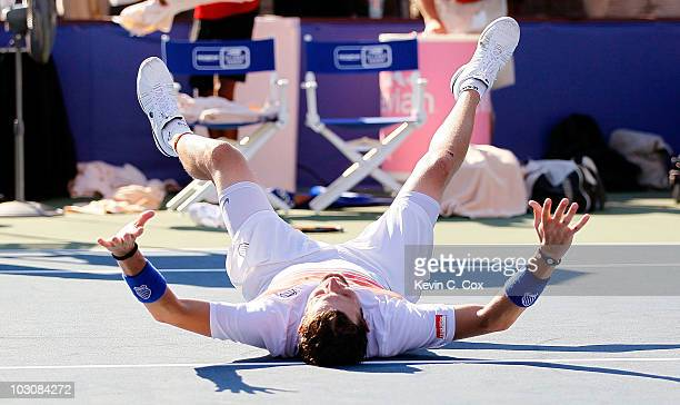 Mardy Fish falls to the court celebrating his win over John Isner in the finals of the Atlanta Tennis Championships at the Atlanta Athletic Club on...