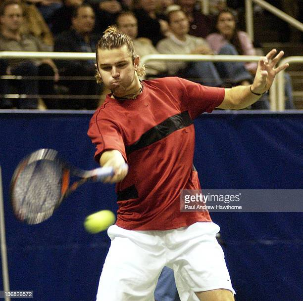 Mardy Fish hits a return shot during his finals match with Andy Roddick at the 2004 Siebel Open in San Jose, California, February 15, 2004. Roddick...