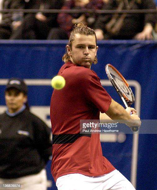 Mardy Fish hits a return shot during his match with Andre Agassi at the 2004 Siebel Open in San Jose, California, February 14, 2004. Fish upset...