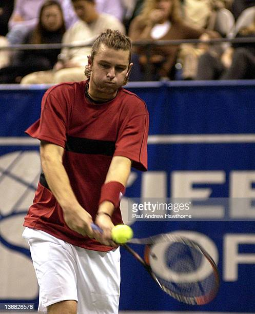 Mardy Fish hits a return shot during his match with HyungTaik Lee of at the 2004 Siebel Open in San Jose California February 13 2004 Fish won the...