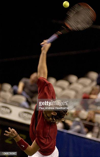 Mardy Fish hits a serve during his match with HyungTaik Lee of at the 2004 Siebel Open in San Jose California February 13 2004 Fish won the match 62...