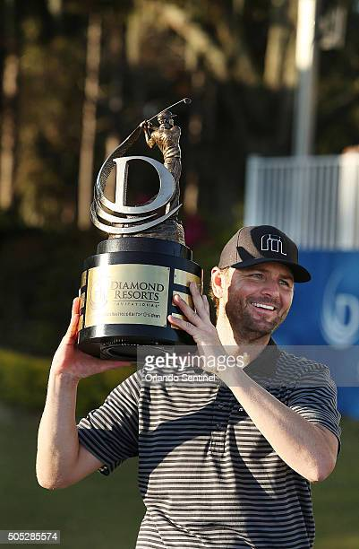 Mardy Fish holds the championship trophy after winning the Diamond Resorts Invitational at The Golden Bear Club at Keene's Point in Wintermere Fla on...