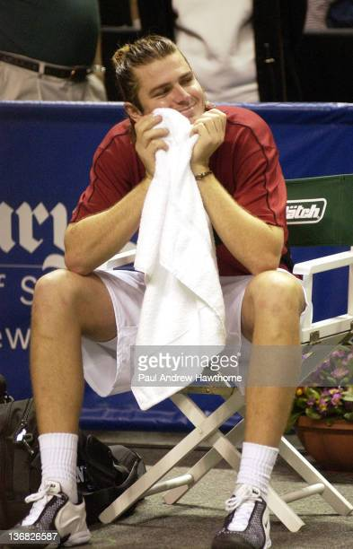Mardy Fish laughs at humorous comments by Andy Roddick during Roddick's interview after their finals match at the 2004 Siebel Open in San Jose...