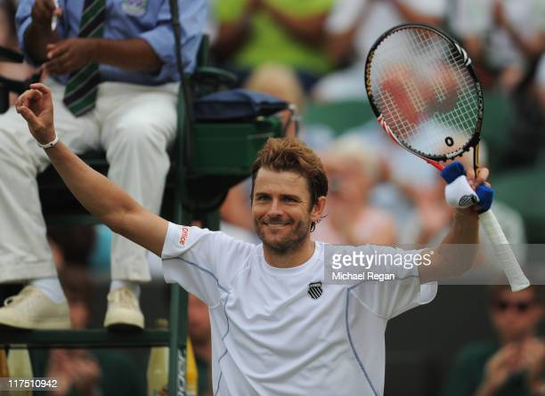 Mardy Fish of the United States celebrates after winning his fourth round match against Tomas Berdych of the Czech Republic on Day Seven of the...