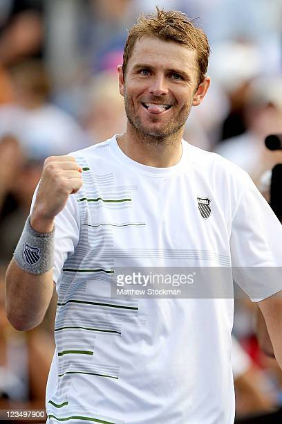 Mardy Fish of the United States celebrates his win over Kevin Anderson of South Africa during Day Six of the 2011 US Open at the USTA Billie Jean...