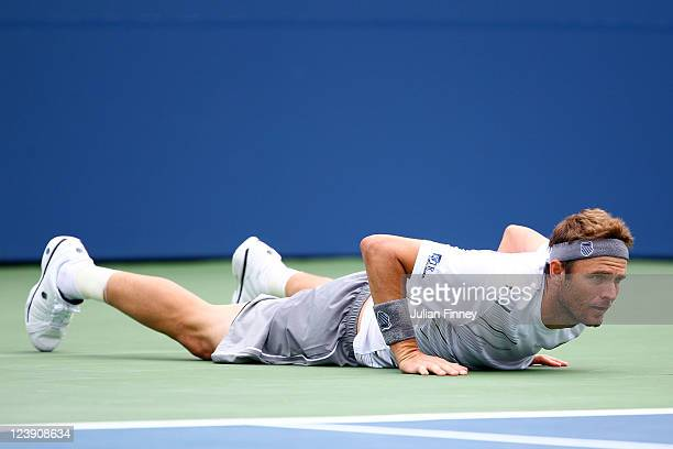 Mardy Fish of the United States falls to the court while playing against JoWilfried Tsonga of France during Day Eight of the 2011 US Open at the USTA...