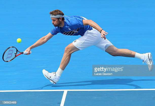 Mardy Fish of the United States plays a backhand during his match against Jurgen Melzer of Austria during day three of the 2012 Kooyong Classic at...